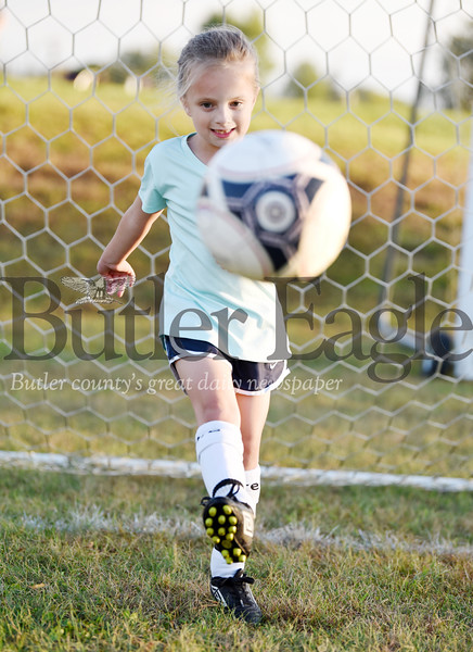 Harold Aughton/Butler Eagle: Kinley Manges, 8, practices her kicks during a recent Mars Area Soccer Club's practice.