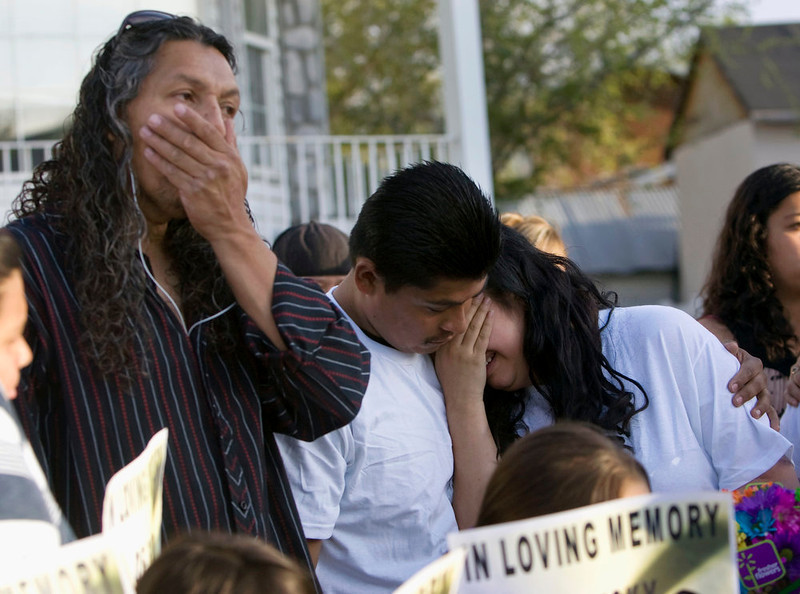 . Antonio Lopez, from left, with Juan Munoz, and Johana Portillo-Lopez, daughter of Ricardo Portillo, who died after injuries following an assault by a soccer player on April 27, becomes emotional after a news conference discussing Portillo\'s death, Sunday, May 5, 2013, in Salt Lake City. Police have accused a 17-year-old player in an April 27 recreational soccer league game of punching Portillo after he called a foul on him and issued him a yellow card. Portillo died Saturday after a week in a coma. (AP Photo/The Salt Lake Tribune, Kim Raff)