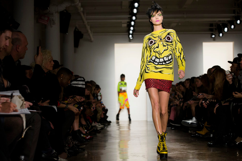 Description of . The Jeremy Scott Fall 2013 collection is modeled during Fashion Week in New York, Wednesday, Feb. 13, 2013. (AP Photo/John Minchillo)