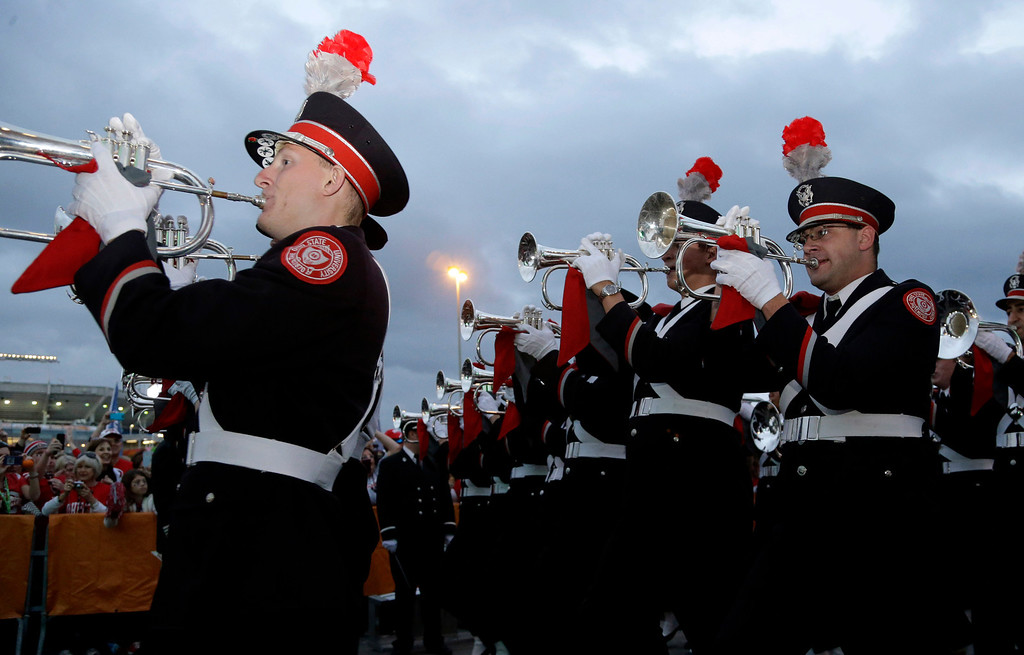 . The Ohio State marching fan performs for fans before the Orange Bowl NCAA college football game between Clemson and Ohio State, Friday, Jan. 3, 2014, in Miami Gardens, Fla. (AP Photo/Lynne Sladky)