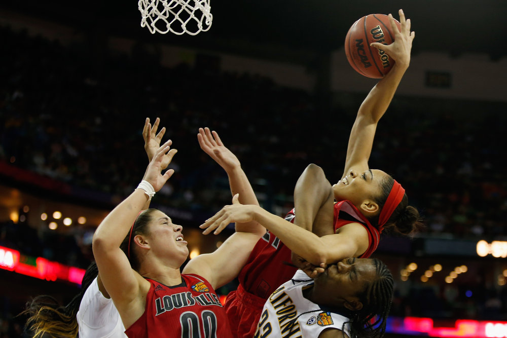 . Bria Smith #21 of the Louisville Cardinals grabs a rebound over Talia Caldwell #33 of the California Golden Bears during the National Semifinal game of the 2013 NCAA Division I Women\'s Basketball Championship at the New Orleans Arena on April 7, 2013 in New Orleans, Louisiana. The Cardinals defeated the Golden Bears 64-57.  (Photo by Chris Graythen/Getty Images)