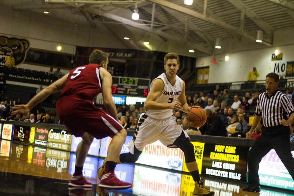 . #3 Travis Bader dribbles around his defender. Photo by Dylan Dulberg