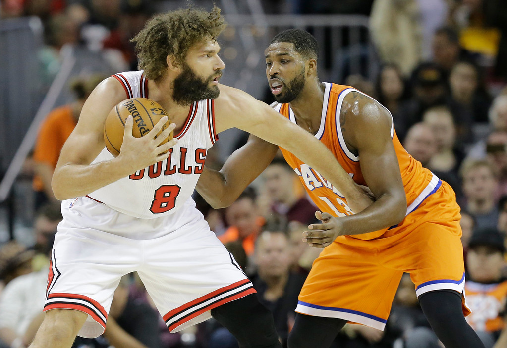 . Chicago Bulls\' Robin Lopez (8) drives against Cleveland Cavaliers\' Tristan Thompson (13) in the first half of an NBA basketball game, Wednesday, Jan. 4, 2017, in Cleveland. (AP Photo/Tony Dejak)