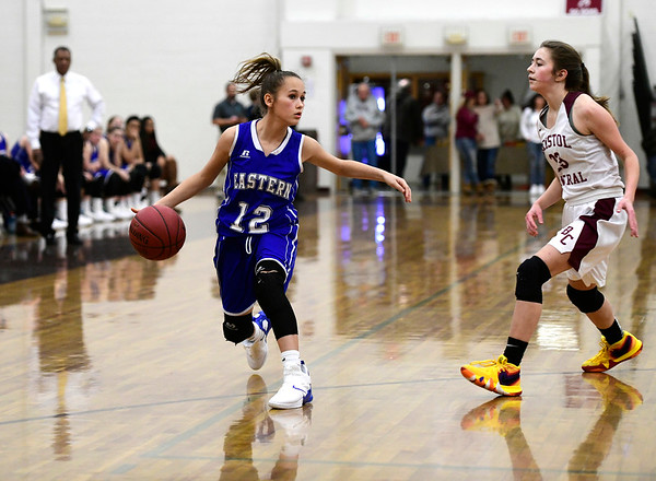 1/17/2019 Mike Orazzi | Staff Bristol Eastern's CCaliRose Doyon (12) and Bristol Central's Ella Watson (23) during Thursday night's girls basketball game with Bristol Central at BC.