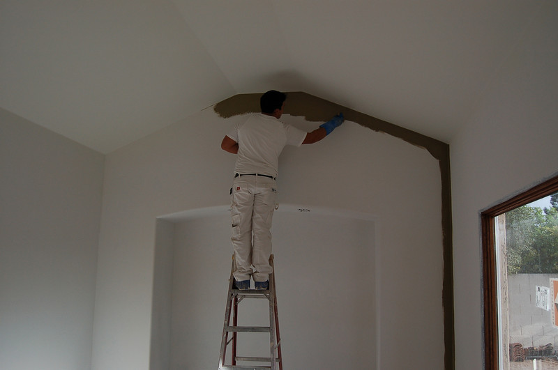 Vladi is cutting in the ceiling in the dining room.