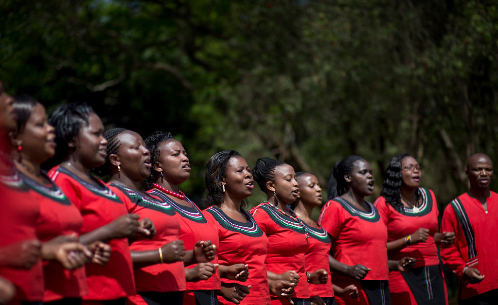 . A Kenyan choir sings at a memorial service and tree-planting marking the one-month anniversary of the the Sept. 21 Westgate Mall terrorist attack, in Karura Forest in Nairobi, Kenya Monday, Oct. 21, 2013. (AP Photo/Ben Curtis)