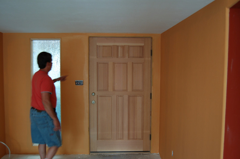 The front door is hung, but not yet stained and finished.