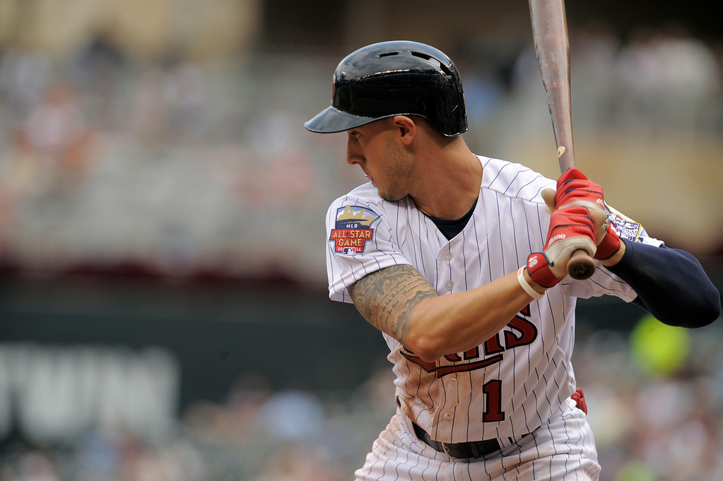 . Minnesota Twins\' Jordan Schafer bats against the Detroit Tigers a baseball game in Minneapolis, Sunday, Aug. 24, 2014. (AP Photo/Tom Olmscheid)