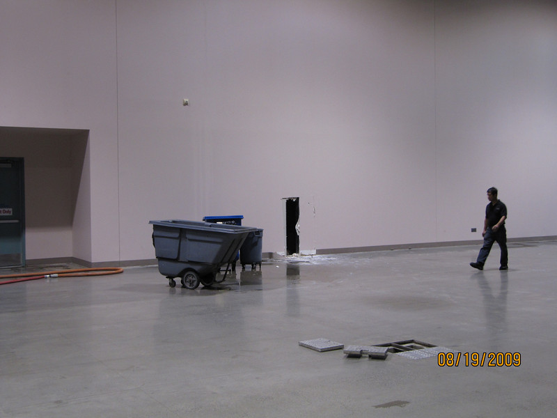 A convention center worker surveys the damage.