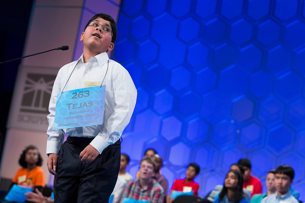 ". Tejas Muthusamy of Glen Allen, Va., reacts after spelling ""llanero\"" correctly during the semifinal round of the National Spelling Bee, Thursday, May 29, 2014, in Oxon Hill, Md. (AP Photo/ Evan Vucci)"
