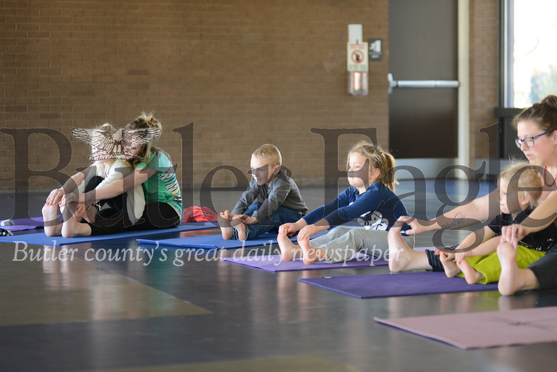 Children and their parents pictured here in the Butler YMCA's new yoga class for preschool age children and their mothers. name; youth