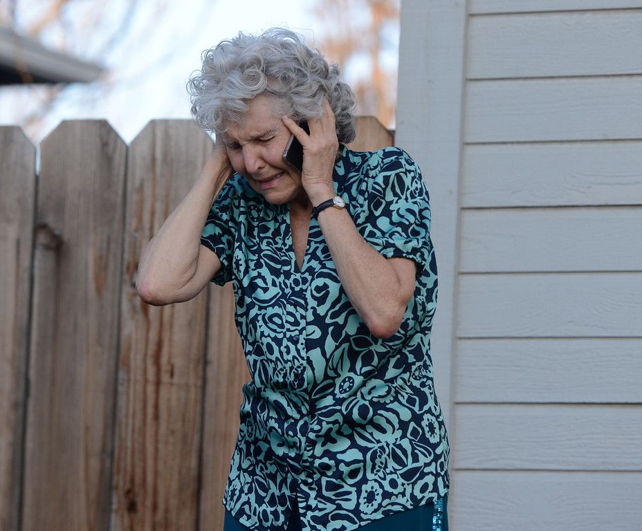 . Patti Geyser, who lives in the 400 block of H Street, reacts to coming home and seeing her home burning in Antioch, Calif., as she speaks on her mobile phone on Wednesday, March 13, 2013. (Susan Tripp Pollard/Staff)