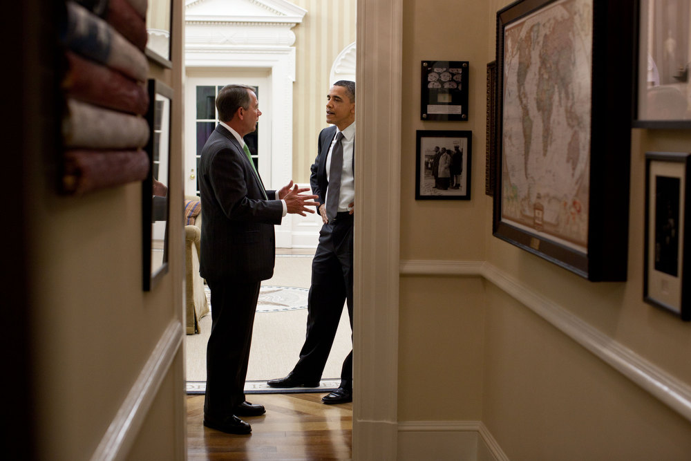 ". April 6, 2011 ""Following the late night meeting on the budget, the President pulled aside House Speaker John Boehner for a private talk in the Oval Office. This was an unusual angle shot from the private dining room looking back through the hallway with the Oval in the background.\"" (Official White House Photo by Pete Souza)"