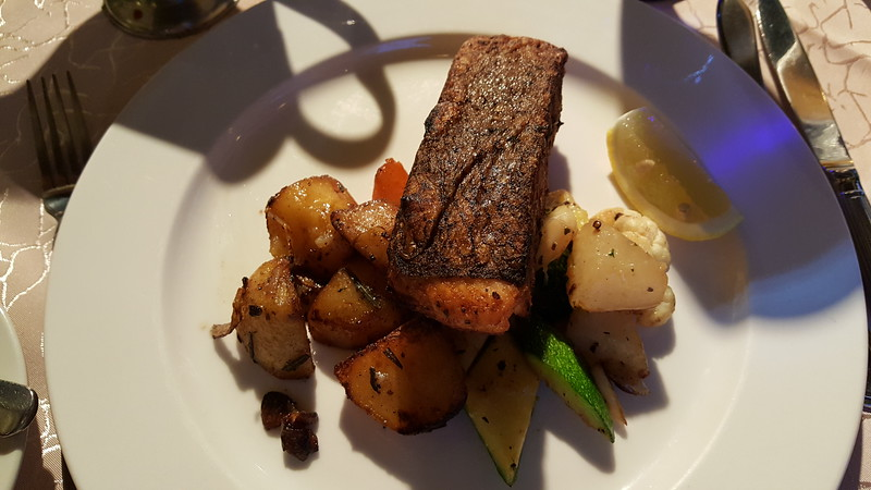 An excellent salmon steak dinner at Cocomo Grill