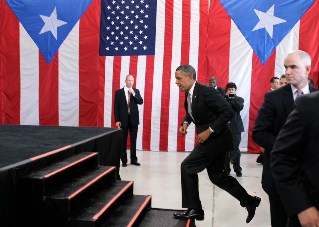 . President Barack Obama arrives at an airport hanger at Muniz Air National Guard Base, Tuesday, June 14, 2011, in San Juan, Puerto Rico. (AP Photo/Carolyn Kaster)