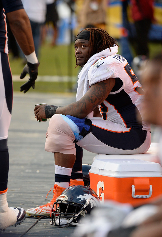 . SAN DIEGO, CA - DECEMBER 14: Denver Broncos outside linebacker Danny Trevathan (59) sits on the cooler as he ices up his left knee against the San Diego Chargers December 14, 2014 at Qualcomm Stadium. Trevathan hobbled off the field during the fourth quarter.  (Photo By John Leyba/The Denver Post)