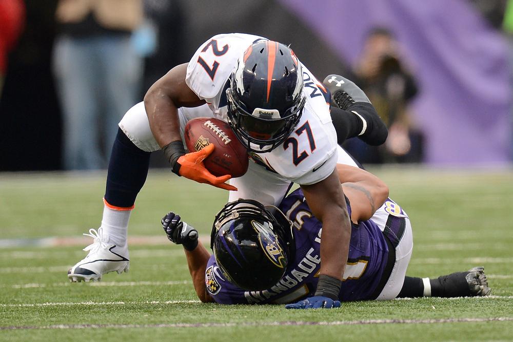 . Denver Broncos running back Knowshon Moreno #27 runs over Baltimore Ravens inside linebacker Brendon Ayanbadejo #51 at the M&T Bank Stadium, in Baltimore , MD Sunday December 16, 2012.      Joe Amon, The Denver Post