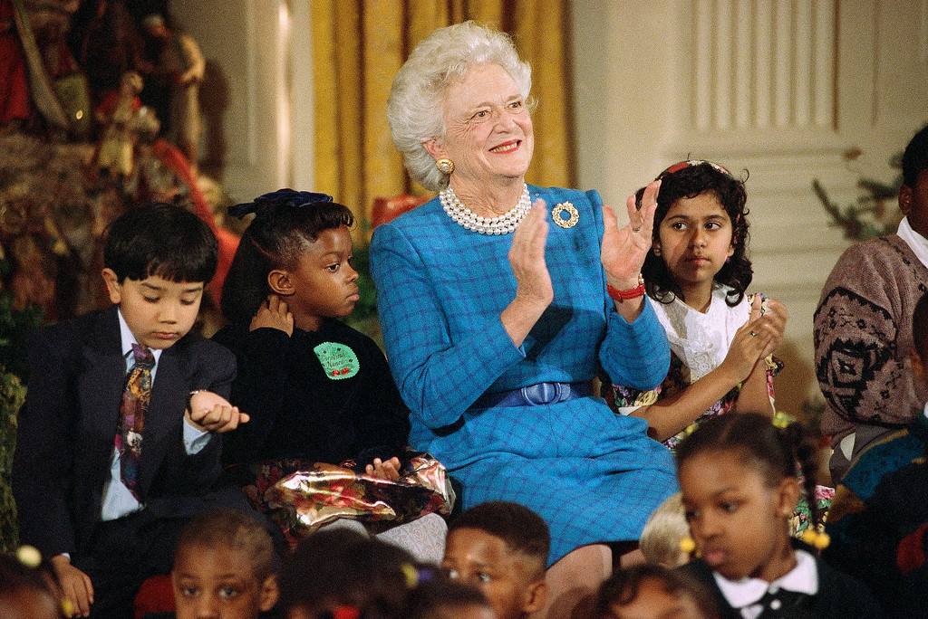 . First lady Barbara Bush is joined by Washington area school children during a children?s Christmas party at the White House in Washington Wednesday, Dec. 11, 1991. From left are, David Hoai, second grader, Long Branch School, Arlington, Va., Christina Nance, second grader, Concord Elementary School, Forestville, Md., Mrs. Bush; and Yogita Tailor, third grader, Carole Highlands Elementary School, Takoma Park, Md. (AP Photo/Marcy Nighswander)
