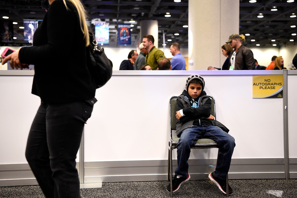 . SAN FRANCISCO, CA - FEBRUARY 05: Bronco fan Diego Zuniga 9, of San Diego waiting on Radio Row while his parents watch the interviews at the Moscone Center in downtown San Francisco, CA. February 05, 2016 (Photo by Joe Amon/The Denver Post)