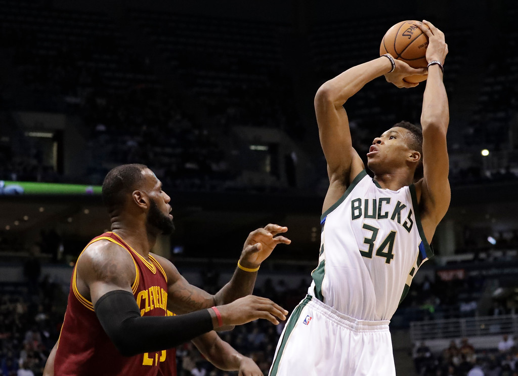 . Milwaukee Bucks\' Giannis Antetokounmpo shoots over Cleveland Cavaliers\' LeBron James during the second half of an NBA basketball game Tuesday, Nov. 29, 2016, in Milwaukee. (AP Photo/Morry Gash)