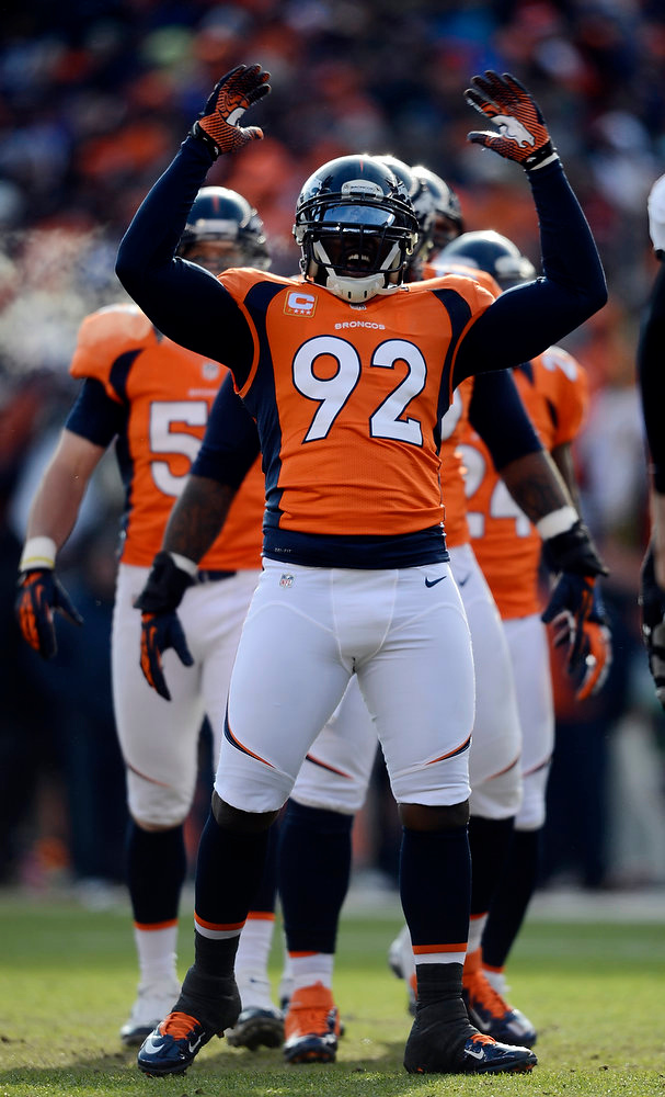 . Denver Broncos defensive end Elvis Dumervil (92) amps up the crowd prior to the start of the Denver Broncos vs Baltimore Ravens AFC Divisional playoff game at Sports Authority Field Saturday January 12, 2013. (Photo by Hyoung Chang,/The Denver Post)
