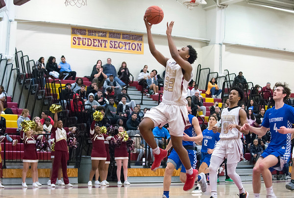 02/18/20 Wesley Bunnell | Staff New Britain boys basketball was defeated at home by Glastonbury on Tuesday night. Gerard Brown (33) with a layup attempt.