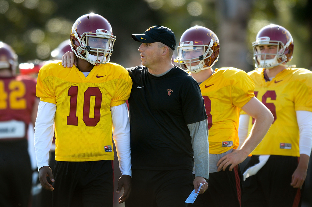 . USC quarterbacks coach Clay Helton talks with QB Jalen Greene at practice, Thursday, March 27, 2014, at USC. (Photo by Michael Owen Baker/L.A. Daily News)