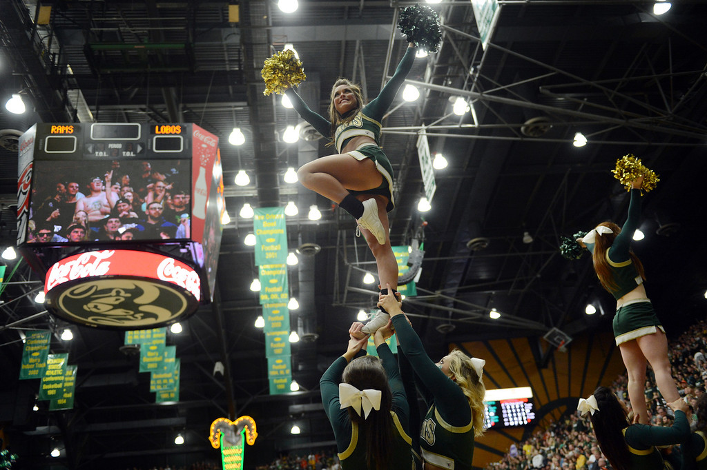 . Fort COLLINS, CO. - FEBRUARY 23: CSU cheerleaders entertain the crowd during second half action at Moby Arena in Fort Collin, CO February  24, 2013. The Colorado State Rams mens basketball team lost to the New Mexico Lobos, 82-91. (Photo By Craig F. Walker/The Denver Post)