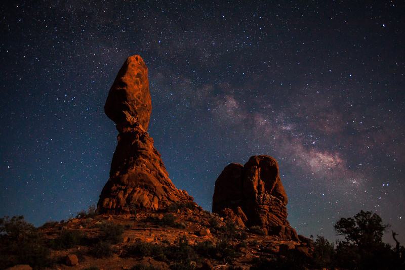 Balance Rock  lit by moonlight with the Milkyway. Arches National Park, Utah