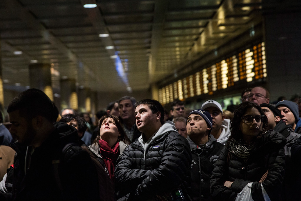 . NEW YORK, NY - JANUARY 26:  People wait for their train platform to be announced at Penn Station while a major snowstorm begins on January 26, 2015 in New York City. The storm is expected to bring 1-3 feet of snow to the New York City region over the next 36 hours.  (Photo by Andrew Burton/Getty Images)
