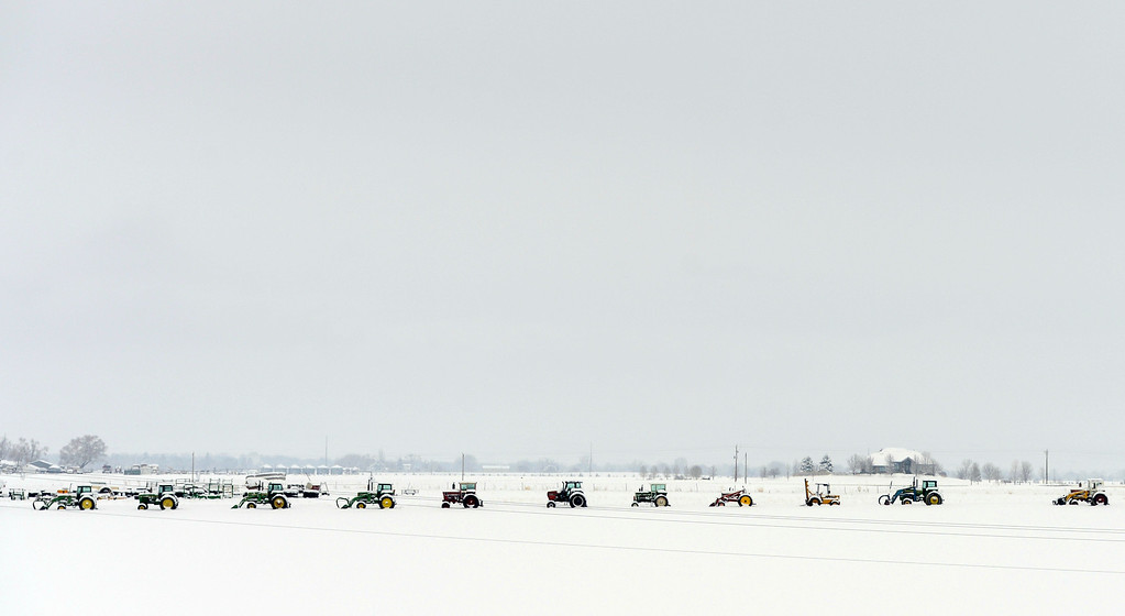 . Farm equipment is lined up in a field near Berthoud, April 16, 2013. A spring snow storm hit northern Colorado covering the field in fresh snow. (Photo By RJ Sangosti/The Denver Post)