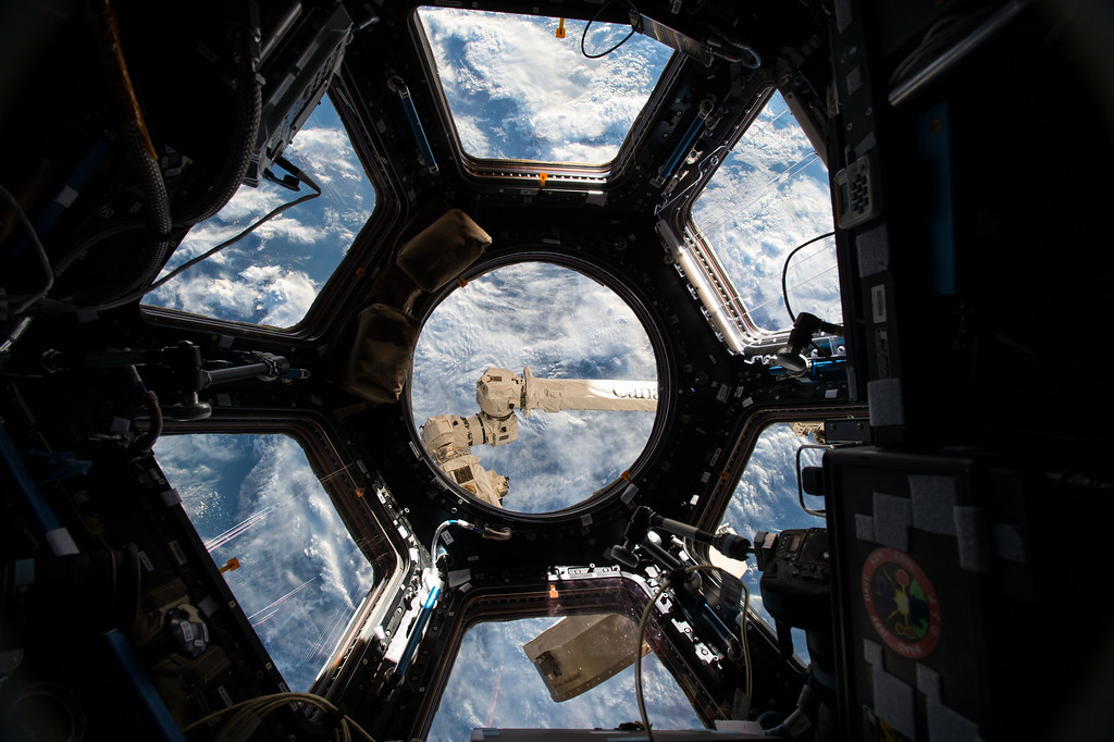 """. This June 4, 2015 photo made available by NASA shows the Cupola, a 360 degree observation area and remote control location for grappling, docking and undocking spacecraft on the International Space Station. Astronaut Scott Kelly tweeted \""""Often when I look out the window I think we should call it Planet Water instead of Earth. Sadly mostly saltwater.\"""" (Scott Kelly/NASA via AP)"""