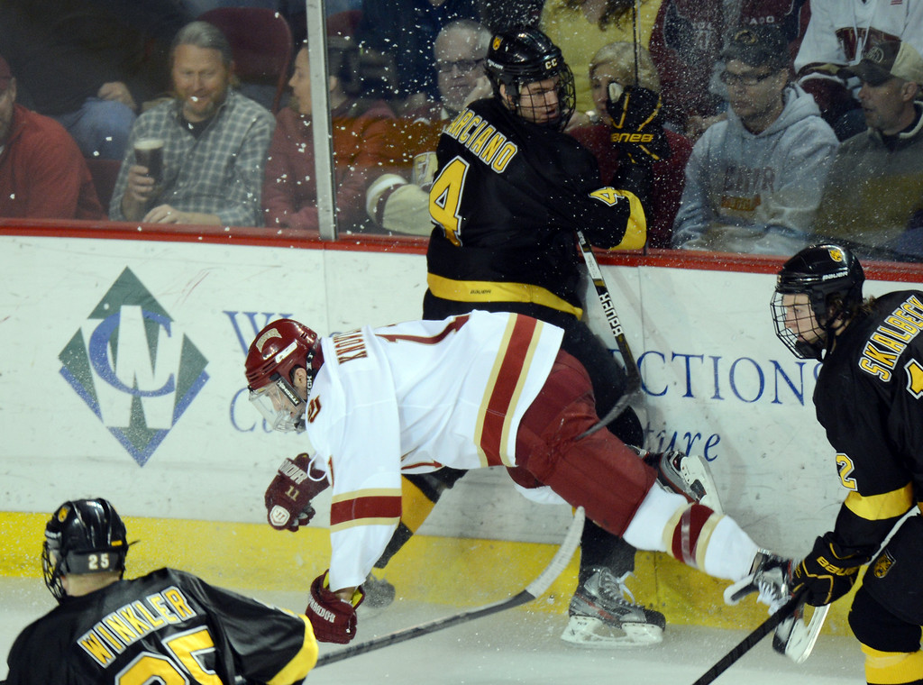 . DENVER, CO. - FEBRUARY 08: Chris Knowlton of University of Denver #11 checks Joe Marciano of Colorado College #4 February 8, 2013 at Magness Arena in Denver, Colorado. The game was over 1-1 in OT. (Photo By Hyoung Chang/The Denver Post)