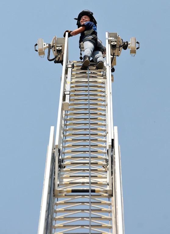 . (John Valenzuela/Staff Photographer) Anastasia Belska 18, of Redlands smiles after climbing 105 ft. up the Redlands ladder truck during the Redlands Emergency Services Academy (R.E.S.A) ladder training at the University of Redlands, Thurssday, July 18, 2013.