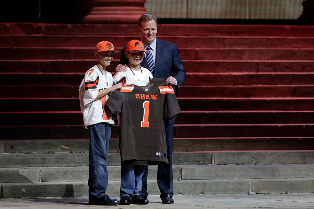 . NFL commissioner Roger Goodell, right, poses with Cleveland Browns\' fans after the Browns selected Texas A&M\'s Myles Garrett with the number one overall pick by the Cleveland Browns during the first round of the 2017 NFL football draft, Thursday, April 27, 2017, in Philadelphia. (AP Photo/Julio Cortez)