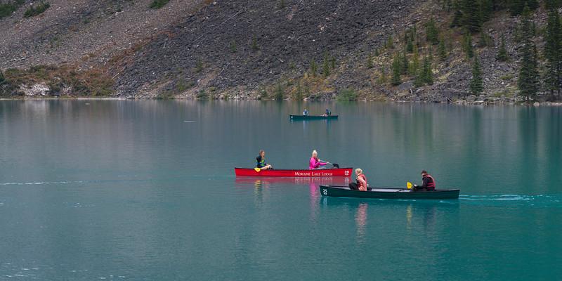 Tourists boating in Moraine Lake, Banff National Park, Alberta, Canada