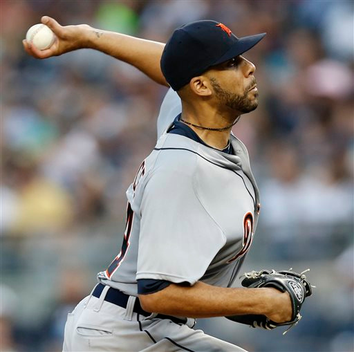 . Detroit Tigers starting pitcher David Price winds up in the first inning of a baseball game against the New York Yankees at Yankee Stadium in New York, as he makes his debut with the Tigers on Tuesday, Aug. 5, 2014. (AP Photo/Kathy Willens)