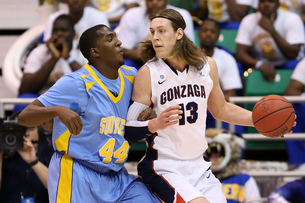 . SALT LAKE CITY, UT - MARCH 21:  Kelly Olynyk #13 of the Gonzaga Bulldogs posts up Javan Mitchell #44 of the Southern University Jaguars in the first half during the second round of the 2013 NCAA Men\'s Basketball Tournament at EnergySolutions Arena on March 21, 2013 in Salt Lake City, Utah.  (Photo by Streeter Lecka/Getty Images)