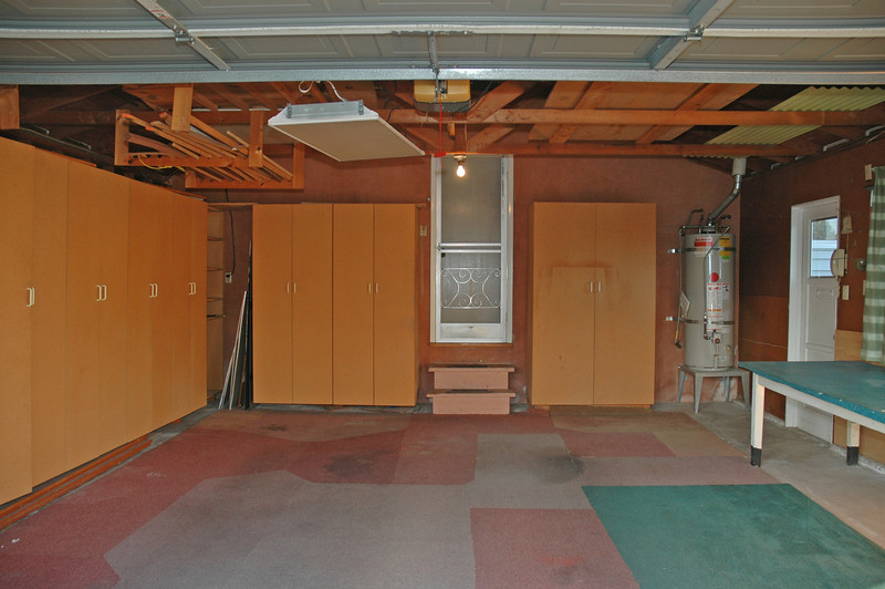 The two-car garage has plenty of built-in storage. Also a garage door opener.
