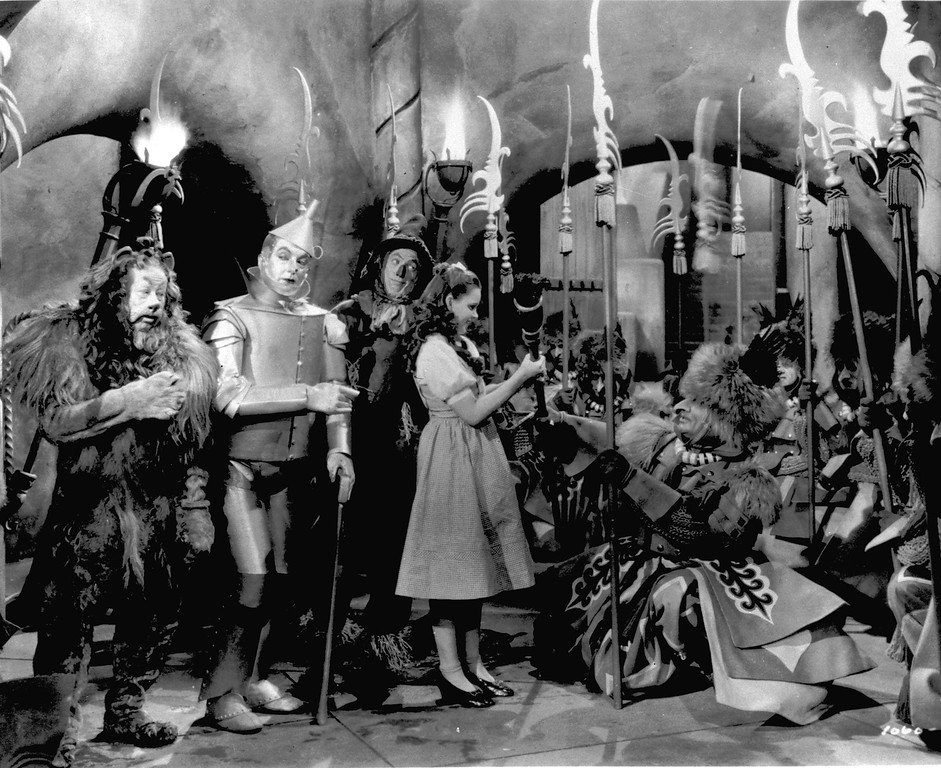 ". Judy Garland, as Dorothy in ""The Wizard of Oz,\"" is presented with the Witch\'s broom in a scene from the 1939 movie.  The movie will be show at the Connor Palace in Cleveland as part of Cinema at the Square.  (Associated Press file)"