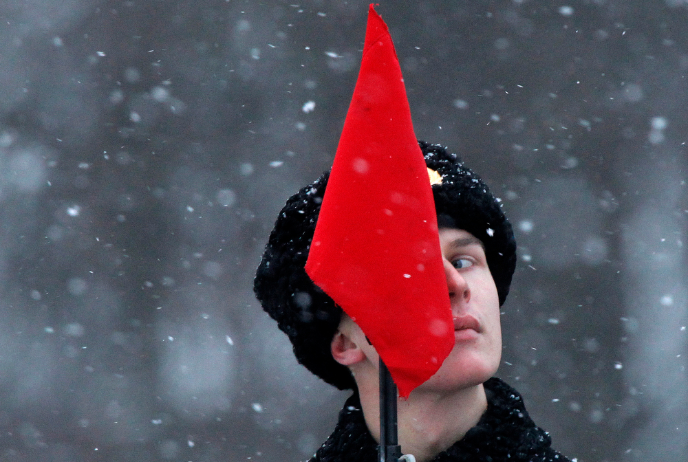 . A soldier looks on during a parade marking the 70th anniversary of the battle that lifted the Siege of Leningrad in St.Petersburg, Russia, Monday, Jan. 27, 2014. The Nazi German and Finnish siege and blockade of Leningrad, now known as St. Petersburg, was broken on Jan. 18, 1943 but finally lifted Jan. 27, 1944. More than 1 million people died mainly from starvation during the 900-day siege. (AP Photo/Dmitry Lovetsky)