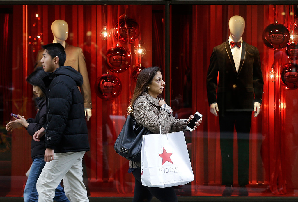 . Shoppers walk past a Macy\'s window display in San Francisco, Friday, Nov. 25, 2016. Black Friday, historically the starting line of the retail industry\'s crucial holiday buying season, isn\'t quite the one-day spree it used to be. Some retailers have pushed their biggest Black Friday door-buster deals into Thanksgiving Day and spread other promotions to even earlier in the season. (AP Photo/Jeff Chiu)
