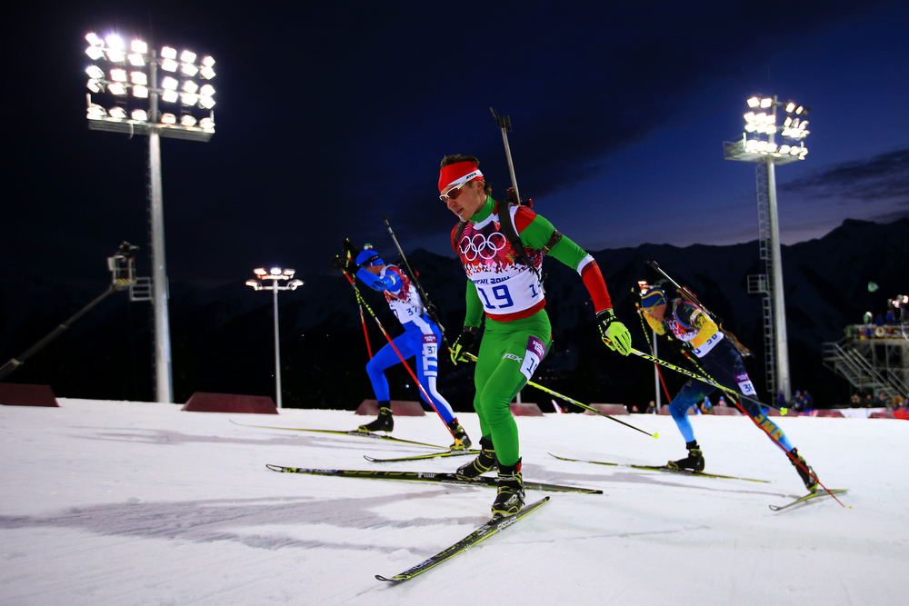 . Vladimir Chepelin (C) of Belarus, Dominik Windisch of Italy and Bjoern Ferry (R) of Sweden compete in the Men\'s Sprint 10 km during day one of the Sochi 2014 Winter Olympics at Laura Cross-country Ski & Biathlon Center on February 8, 2014 in Sochi, Russia.  (Photo by Richard Heathcote/Getty Images)