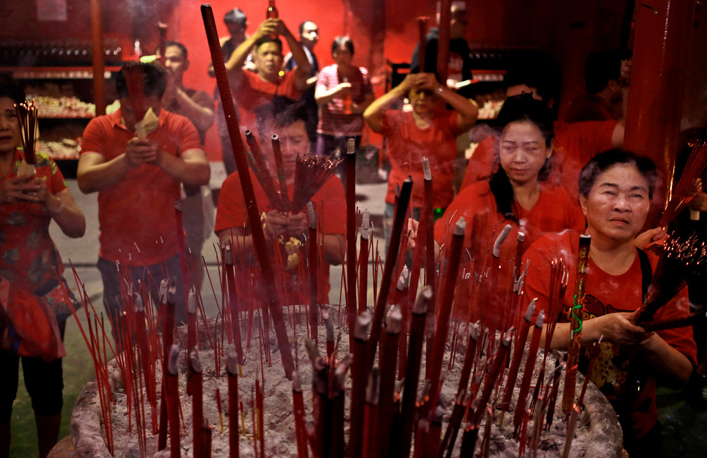. Indonesian ethnic Chinese pray during the celebration of Lunar New Year at a temple in the China Town in Jakarta, Indonesia. (AP Photo/Dita Alangkara)