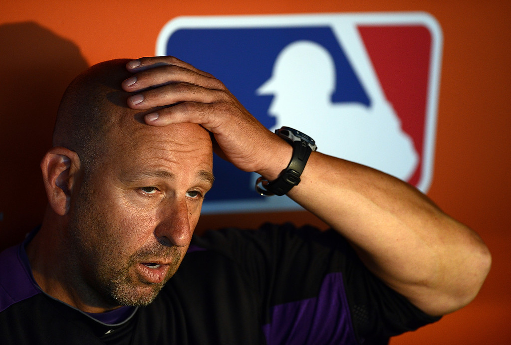 . MIAMI, FL - AUGUST 24: Manager Walt Weiss #22 of the Colorado Rockies watches the game against the Miami Marlins at Marlins Park on August 24, 2013 in Miami, Florida.  (Photo by Jason Arnold/Getty Images)