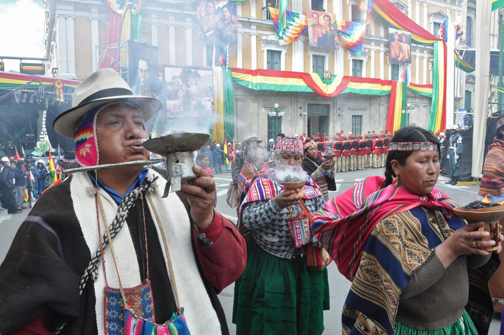Description of . Handout photo released by the bOlivian Presidency of Aymara indigenous people making a ritual during celebrations for the third anniversary of the Plurinational State of Bolivia outside Quemado palace in La Paz, on January 22, 2013. PresidenciaHO/AFP/Getty Images