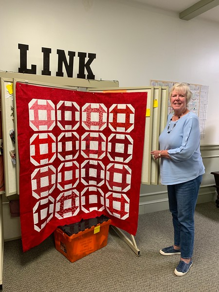 """The winner of the CCQG Board """"house block quilt top"""""""