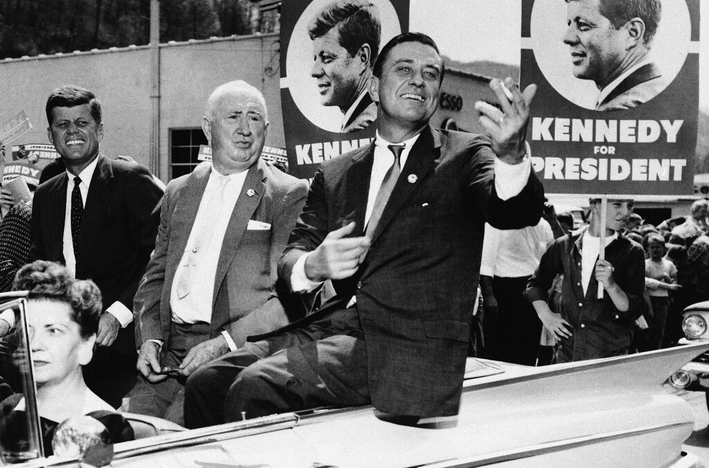 . The political magic of his father\'s name rides with Franklin D. Roosevelt Jr., right, as he tours West Virginia with then Sen. John F. Kennedy on April 27, 1960, during Kennedy\'s campaign for the Democratic presidential nomination. State Sen. Ward Wylie, left, was Kennedy\'s West Virginia campaign chairman. Associated Press file