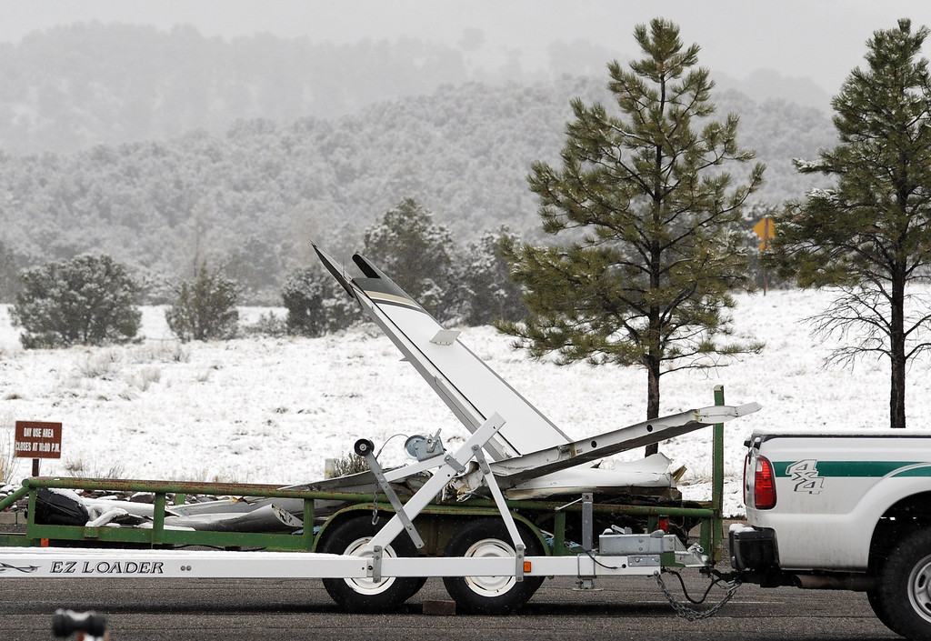 . The tail section of a small aircraft that crashed at the Ridgway Reservoir near Ridgway, Colo.,last Saturday March 22, 2014 killing five people sits on a flatbed trailer for inspection Thursday March 27, 2014, at the Ridgway reservoir marina. (Photo by William Woody/Provided by Ouray County)