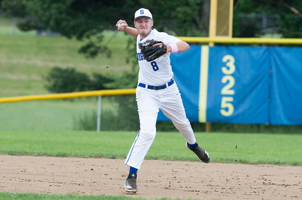 05/29/19 Wesley Bunnell | Staff Southington defeated New Britain 4-3 in 11 innings on a walk off single by Billy Carr (17) in the continuation of a game suspended in the 10th inning due to rain on May 29th. Shortstop Jacob Romano (8) fields a ground ball and throws to first for the out.
